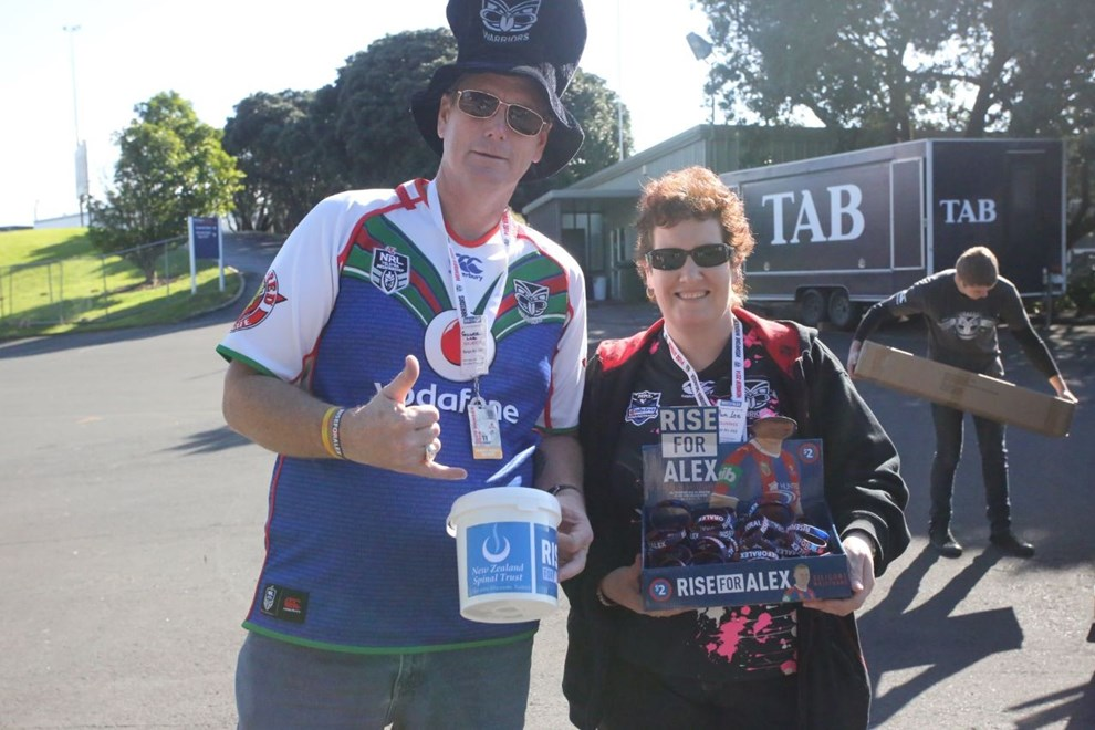 Vodafone Warriors members Graeme and Pam Lee collecting and selling #RiseForAlex wristbands on game day last month. Image | Ra Pomare.