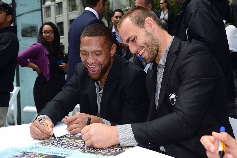 Kiwi captain Simon Mannering (right) and team-mate Manu Vatuvei sign autographs at a civic reception in Wellington on Wednesday. Image | www.photosport.co.nz