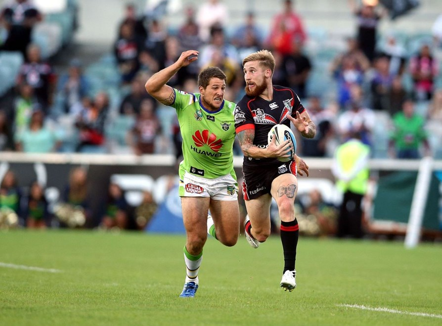 Sam Tomkins chased down by Jack Wighton.Raiders v Warriors NRL rugby league match at GIO Stadium, Canberra Australia. Sunday 15 March 2015. Photo: Paul Seiser/Photosport.co.nz