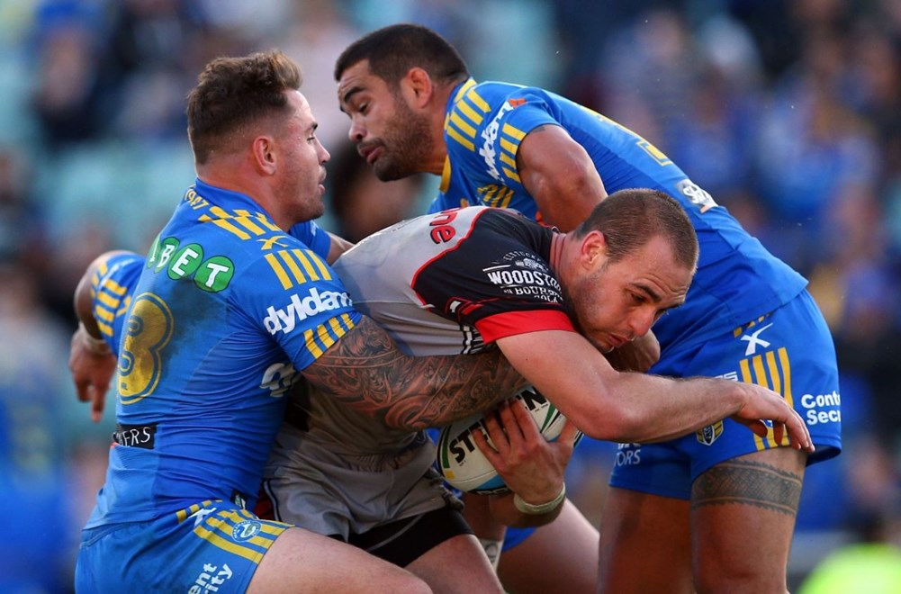 Simon Mannering is tackled by Anthony Watmough and Richie Fa'aoso during the NRL rugby league match between the Eels and the Warriors at Pirtek Stadium; Parramatta, Australia. On Saturday 16th May 2015. Photo: Renee McKay/PHOTOSPORT