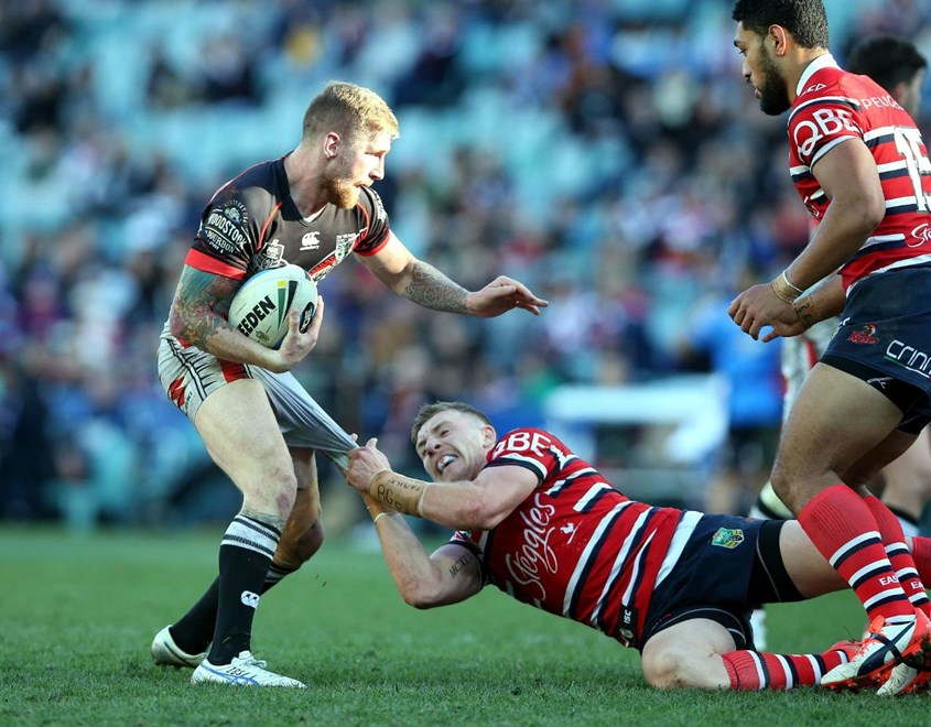 Sam Tomkins tackled by Jackson Hastings Roosters v Warriors NRL rugby league match at Allianz Stadium, Sydney Australia. Sunday 19 July 2015. Photo: Paul Seiser/Photosport.co.nz
