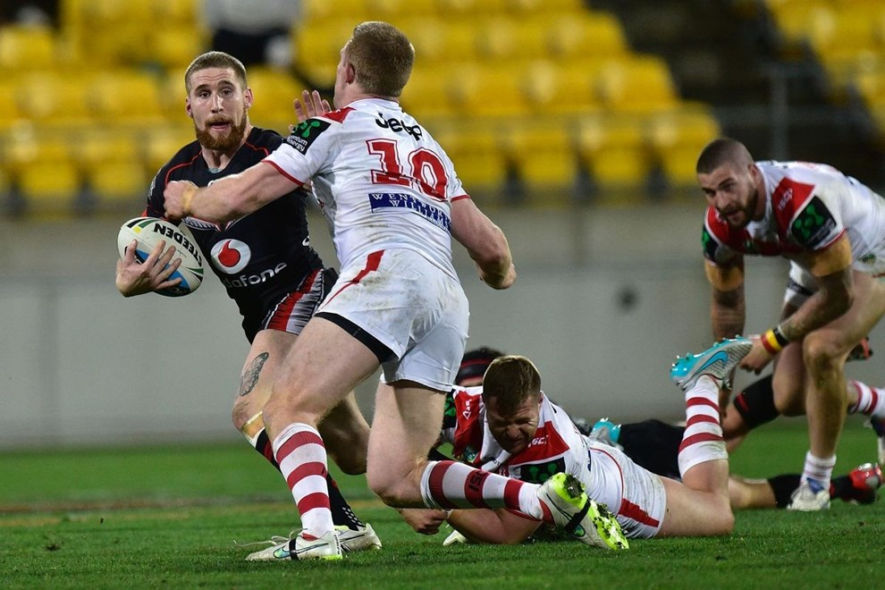 Sam Tomkins of the Warriors is tackled by Ben Creagh of the Dragons during the NRL Rugby League match between the Vodafone Warriors & St George Illawarra Dragons at the Westpac Stadium in Wellington on Saturday the 8th August 2015. Copyright photo by Marty Melville
