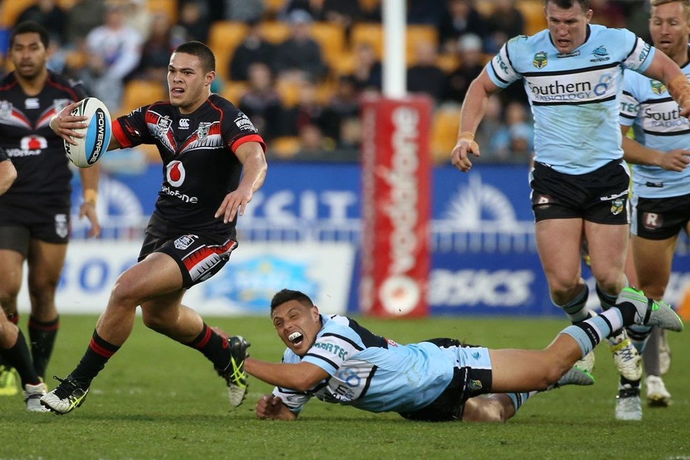 Warriors player Tuimoala Lolohea gets past Sharks tackler Anthony Tupou in the NRL Rugby League, Vodafone Warriors v Cronulla Sharks at Mt Smart Stadium, Auckland, New Zealand 1 August 2015. Copyright Photo: Fiona Goodall / www.photosport.nz