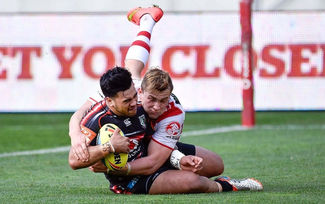 Semisi Tyrell of the Junior Warriors scores a try as he is tackled by Jacob Host captain of the Junior Dragons during the NRL Rugby League Holden Cup match between the Junior Warriors & Junior Dragons at the Westpac Stadium in Wellington on Saturday the 8th August 2015. Copyright Photo