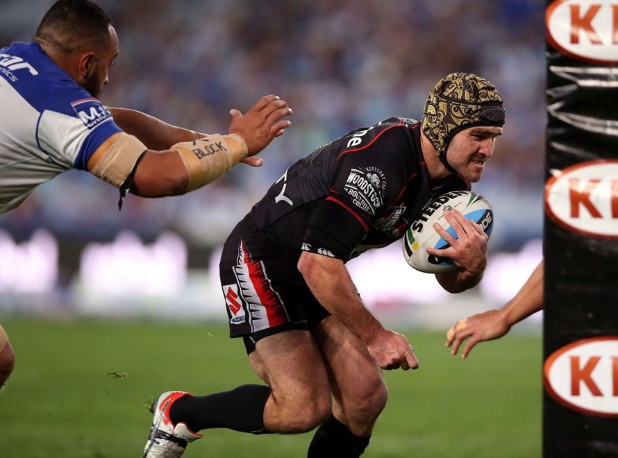 Nathan Friend drives through for a try Bulldogs v Warriors NRL rugby league match at ANZ Stadium, Homebush Australia. Sunday 5 September 2015. Photo: Paul Seiser/Photosport.co.nz