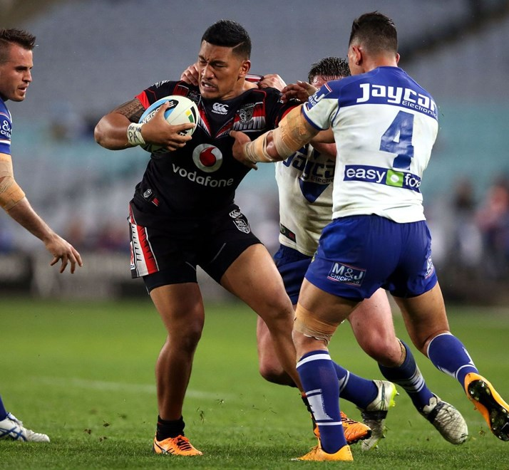 Albert Vete tackled by Josh Jackson and Tim Lafai Bulldogs v Warriors NRL rugby league match at ANZ Stadium, Homebush Australia. Sunday 5 September 2015. Photo: Paul Seiser/Photosport.nz
