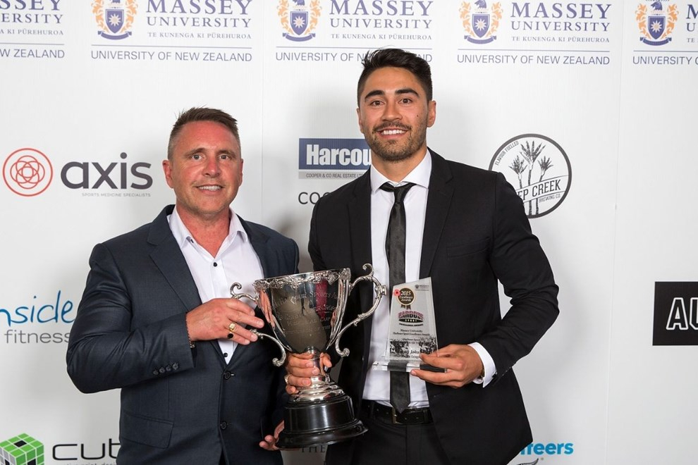 Vodafone Warrior Shaun Johnson with his father Paul after being named the Harbour Sport Sportsman of the Year at the Massey University Harbour Sport Excellence Awards on Friday night.