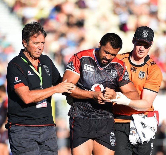 Vodafone Warriors forward Ligi Sao is helped off the field by team doctor John Mayhew and physiotherapist John Love during Saturday's NRL trial against the Dragons. Image | www.photosport.nz