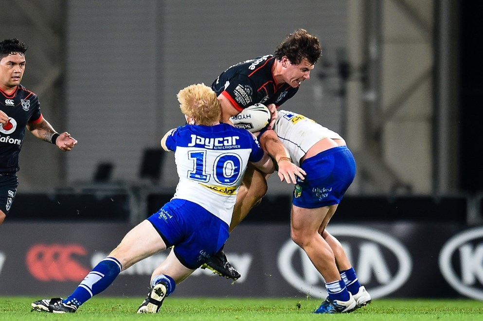 Charlie Gubb of The Warriors gets tackled during the NRL Rugby League match