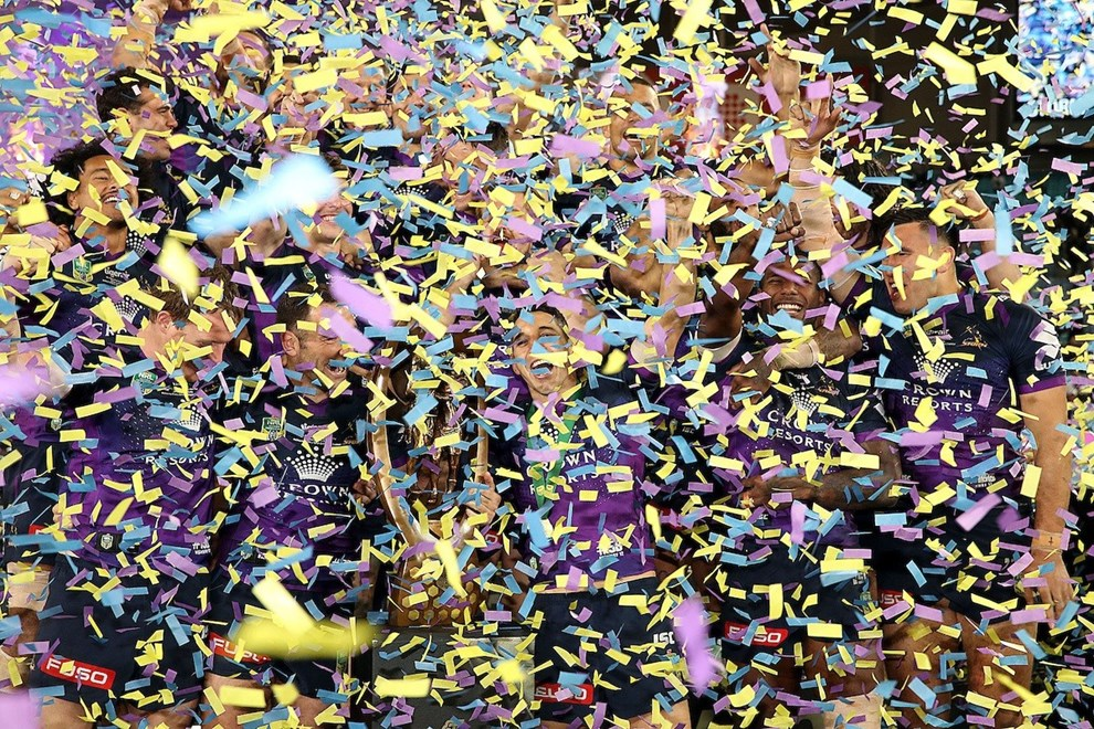 Billy Slater and Cameron Smith surrounded by confetti Storm v Cowboys NRL rugby league Grand Final at ANZ Stadium, Homebush Australia. Sunday 1 October 2017. Photo: Paul Seiser / www.photosport.nz