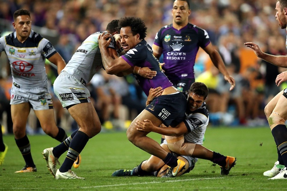 Felise Kaufusi tackled by Te Maire Martin and Justin O'Neill Storm v Cowboys NRL rugby league Grand Final at ANZ Stadium, Homebush Australia. Sunday 1 October 2017. Photo: Paul Seiser / www.photosport.nz
